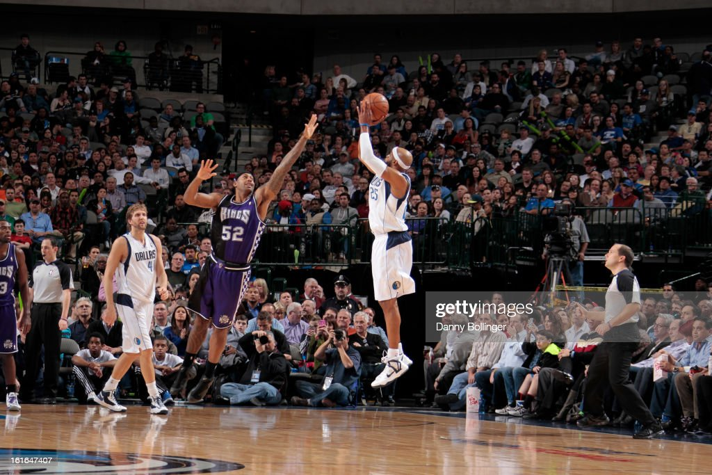 <a gi-track='captionPersonalityLinkClicked' href=/galleries/search?phrase=Vince+Carter&family=editorial&specificpeople=201488 ng-click='$event.stopPropagation()'>Vince Carter</a> #25 of the Dallas Mavericks shoots a three pointer which puts him ahead of Larry Bird on the all-time scoring list against James Johnson #52 of the Sacramento Kings on February 13, 2013 at the American Airlines Center in Dallas, Texas.