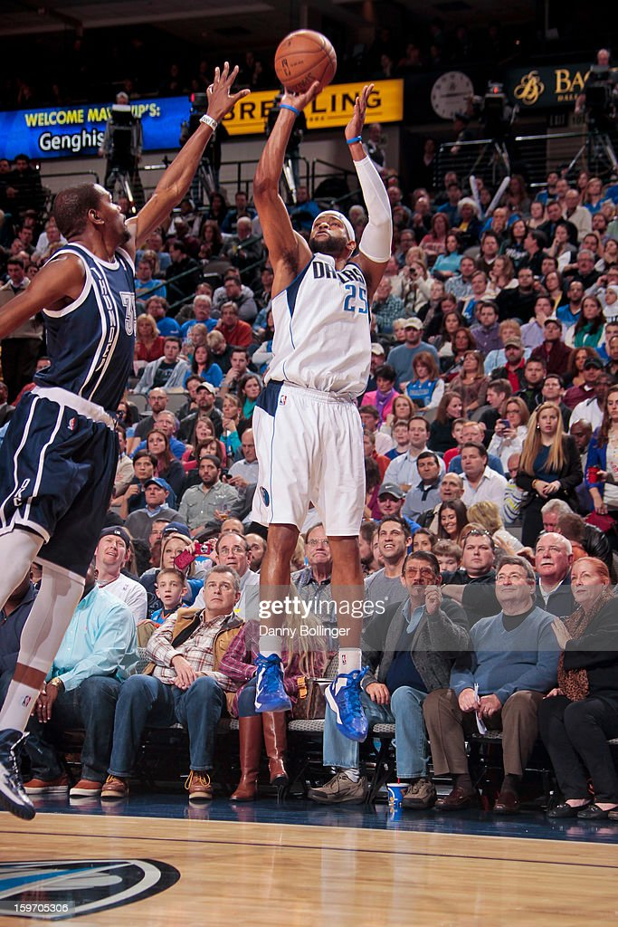 Vince Carter #25 of the Dallas Mavericks shoots a three-pointer against Kevin Durant #35 of the Oklahoma City Thunder on January 18, 2013 at the American Airlines Center in Dallas, Texas.
