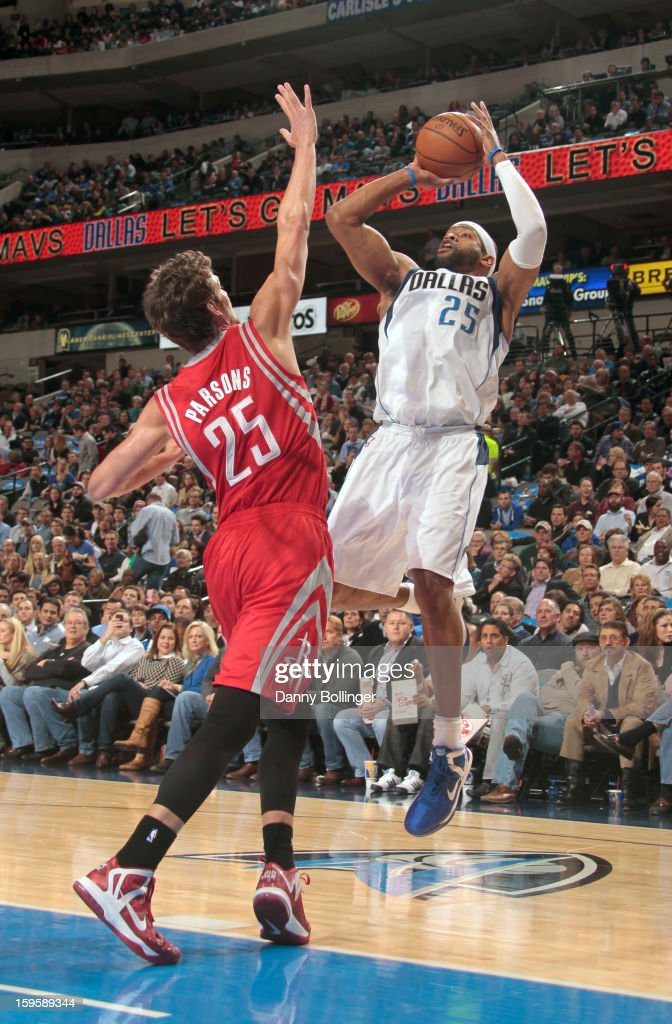 Vince Carter #25 of the Dallas Mavericks shoots against Chandler Parsons #25 of the Houston Rockets on January 16, 2013 at the American Airlines Center in Dallas, Texas.