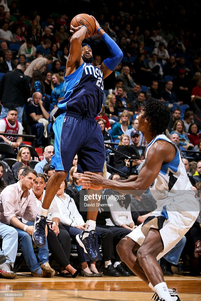 <a gi-track='captionPersonalityLinkClicked' href=/galleries/search?phrase=Vince+Carter&family=editorial&specificpeople=201488 ng-click='$event.stopPropagation()'>Vince Carter</a> #25 of the Dallas Mavericks shoots against the Minnesota Timberwolves on March 10, 2013 at Target Center in Minneapolis, Minnesota.