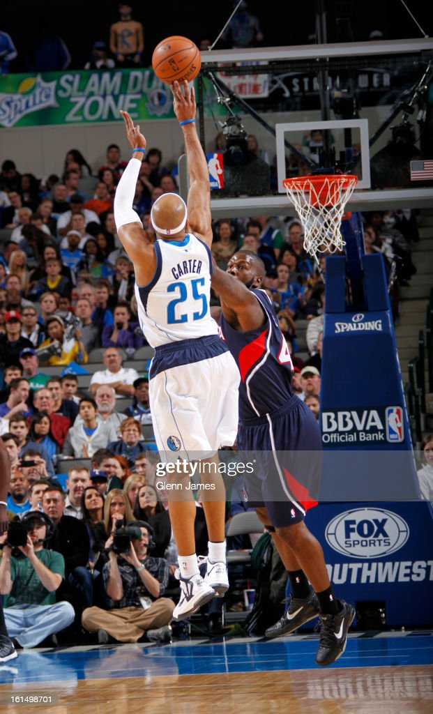 Vince Carter #25 of the Dallas Mavericks shoots the ball against Ivan Johnson #44 of the Atlanta Hawks on February 11, 2013 at the American Airlines Center in Dallas, Texas.