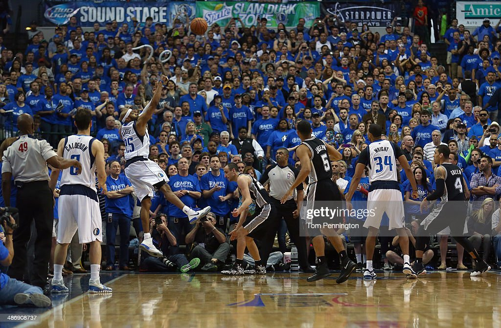 Vince Carter of the Dallas Mavericks shoots the game winning shot as the Mavericks beat the San Antonio Spurs 109108 during Game Three of the Western...