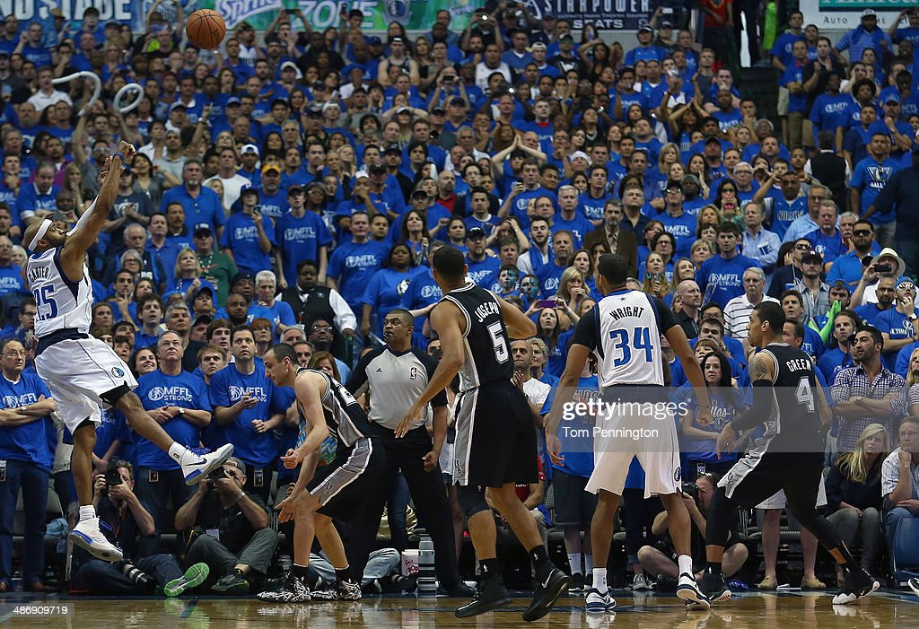 <a gi-track='captionPersonalityLinkClicked' href=/galleries/search?phrase=Vince+Carter&family=editorial&specificpeople=201488 ng-click='$event.stopPropagation()'>Vince Carter</a> #25 of the Dallas Mavericks shoots the game winning shot as the Mavericks beat the San Antonio Spurs 109-108 during Game Three of the Western Conference Quarterfinals during the 2014 NBA Playoffs at American Airlines Center on April 26, 2014 in Dallas, Texas.
