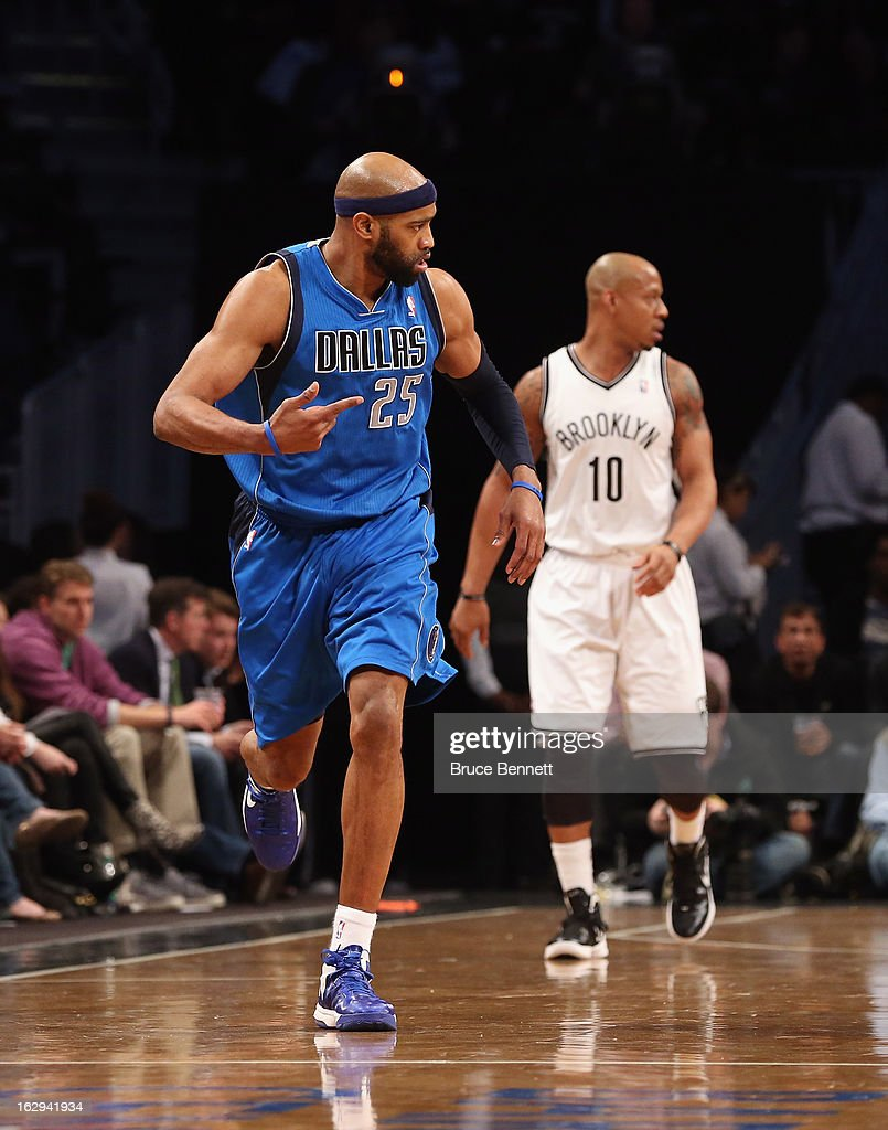 Vince Carter #25 of the Dallas Mavericks signals after scoring a basket in the second half against the Brooklyn Nets at the Barclays Center on March 1, 2013 in New York City.