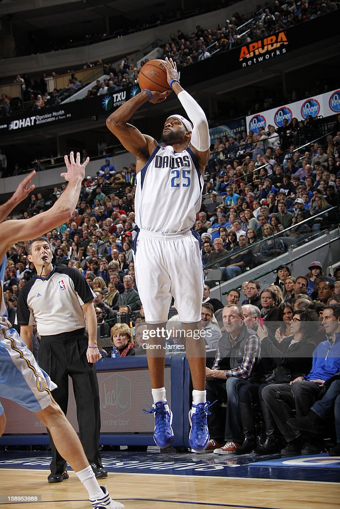<a gi-track='captionPersonalityLinkClicked' href=/galleries/search?phrase=Vince+Carter&family=editorial&specificpeople=201488 ng-click='$event.stopPropagation()'>Vince Carter</a> #25 of the Dallas Mavericks takes a shot against the Denver Nuggets on December 28, 2012 at the American Airlines Center in Dallas, Texas.