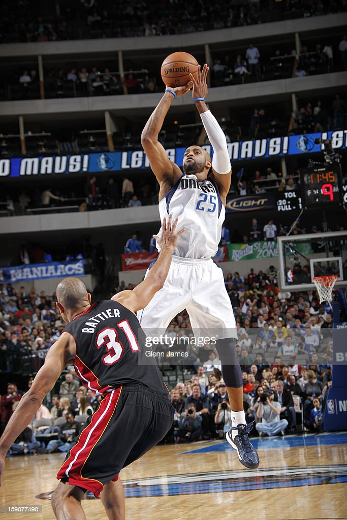 <a gi-track='captionPersonalityLinkClicked' href=/galleries/search?phrase=Vince+Carter&family=editorial&specificpeople=201488 ng-click='$event.stopPropagation()'>Vince Carter</a> #25 of the Dallas Mavericks takes a shot against the Miami Heat on December 20, 2012 at the American Airlines Center in Dallas, Texas.