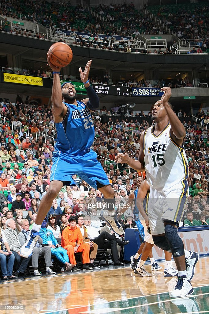 <a gi-track='captionPersonalityLinkClicked' href=/galleries/search?phrase=Vince+Carter&family=editorial&specificpeople=201488 ng-click='$event.stopPropagation()'>Vince Carter</a> #25 of the Dallas Mavericks takes the shot over <a gi-track='captionPersonalityLinkClicked' href=/galleries/search?phrase=Derrick+Favors&family=editorial&specificpeople=5792014 ng-click='$event.stopPropagation()'>Derrick Favors</a> #15 of the Utah Jazz at Energy Solutions Arena on October 31, 2012 in Salt Lake City, Utah.