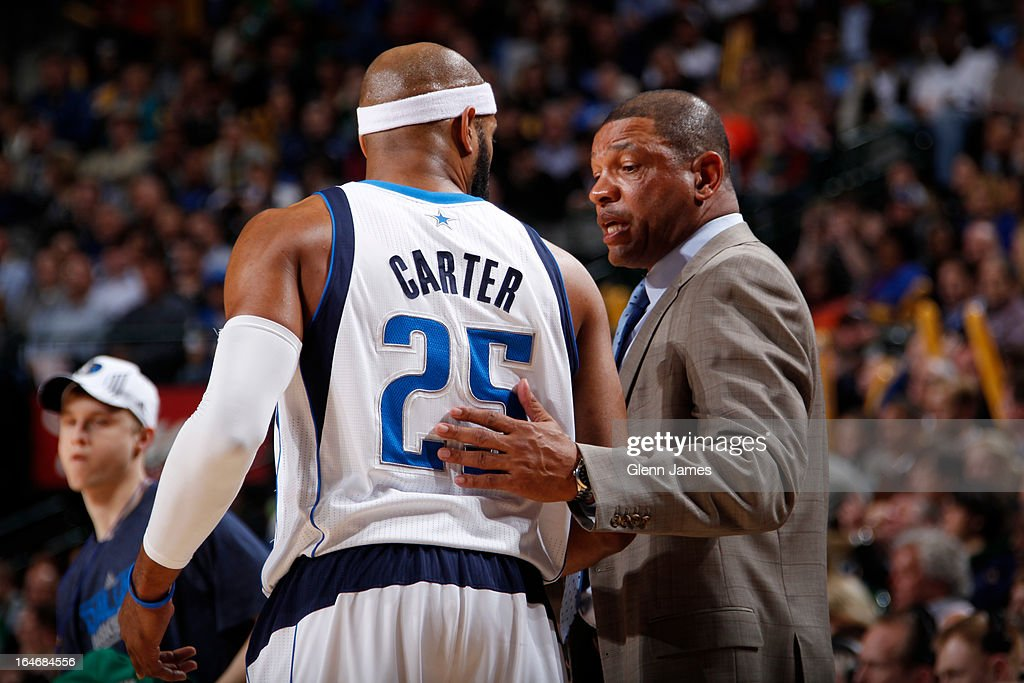 Vince Carter #25 of the Dallas Mavericks talks to <a gi-track='captionPersonalityLinkClicked' href=/galleries/search?phrase=Doc+Rivers&family=editorial&specificpeople=206225 ng-click='$event.stopPropagation()'>Doc Rivers</a> of the Boston Celtics during the game on March 22, 2013 at the American Airlines Center in Dallas, Texas.