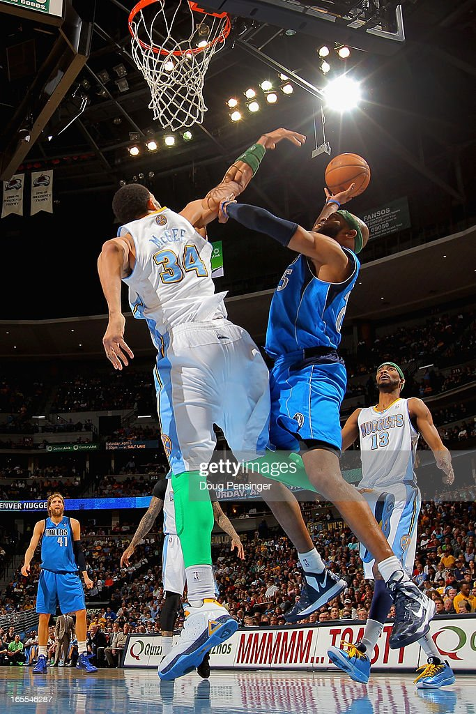 <a gi-track='captionPersonalityLinkClicked' href=/galleries/search?phrase=Vince+Carter&family=editorial&specificpeople=201488 ng-click='$event.stopPropagation()'>Vince Carter</a> #25 of the Dallas Mavericks tries to get off a shot against <a gi-track='captionPersonalityLinkClicked' href=/galleries/search?phrase=JaVale+McGee&family=editorial&specificpeople=4195625 ng-click='$event.stopPropagation()'>JaVale McGee</a> #34 of the Denver Nuggets at the Pepsi Center on April 4, 2013 in Denver, Colorado.