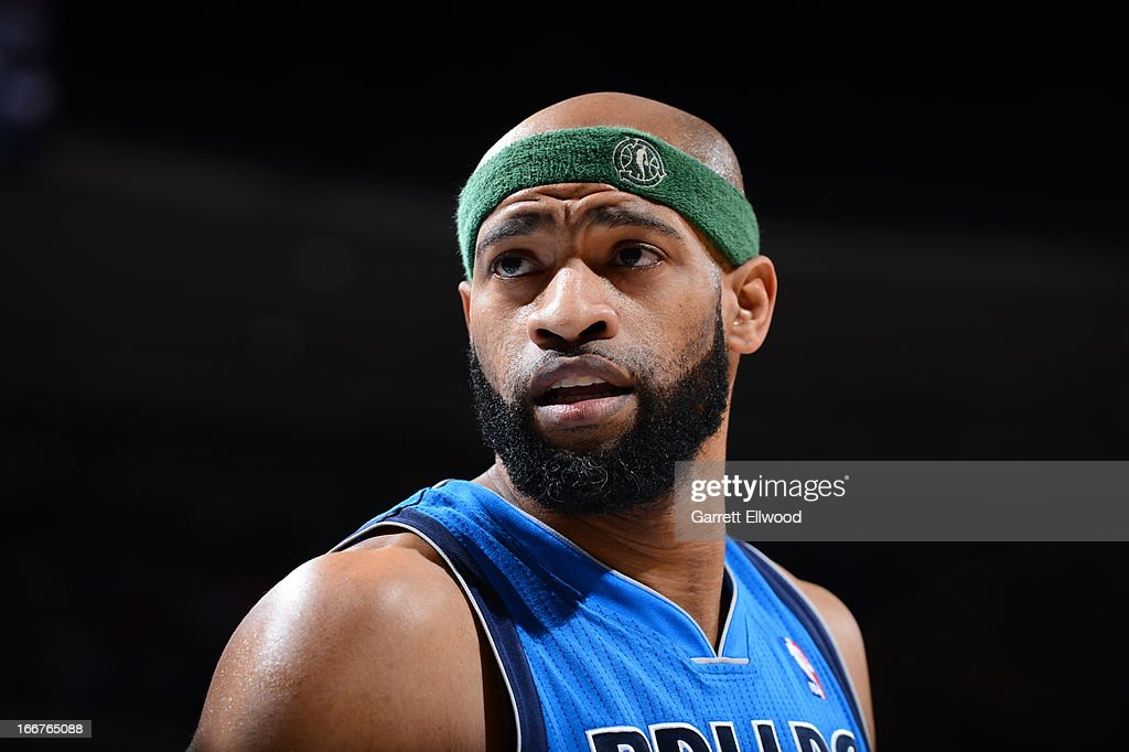 <a gi-track='captionPersonalityLinkClicked' href=/galleries/search?phrase=Vince+Carter&family=editorial&specificpeople=201488 ng-click='$event.stopPropagation()'>Vince Carter</a> #25 of the Dallas Mavericks wears his NBA Green headband against the Denver Nuggets on April 4, 2013 at the Pepsi Center in Denver, Colorado.