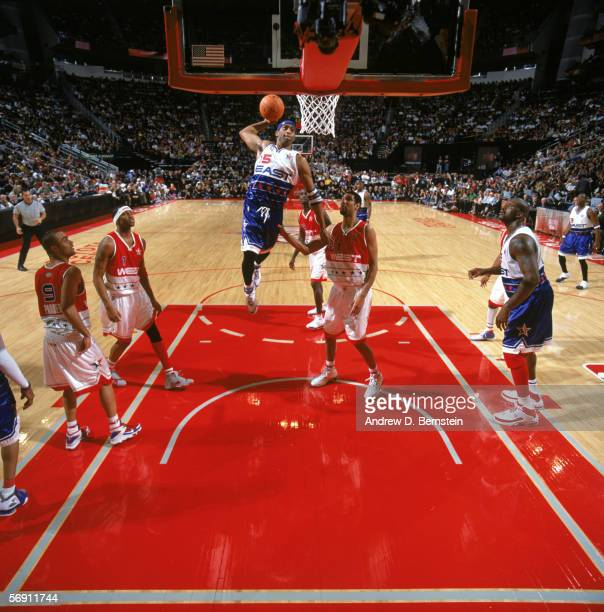 Vince Carter of the East Team dunks against the West Team in the 2006 NBA AllStar Game during NBA AllStar Weekend at the Toyota Center on February 19...