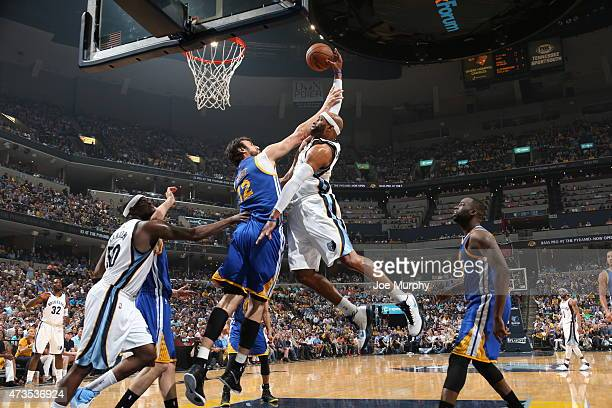 Vince Carter of the Memphis Grizzlies attempts a dunk against the Golden State Warriors in Game Six of the Western Conference Semifinals of the NBA...