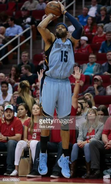 Vince Carter of the Memphis Grizzlies shoots a threepoint shot against the Houston Rockets at Toyota Center on March 4 2017 in Houston Texas NOTE TO...
