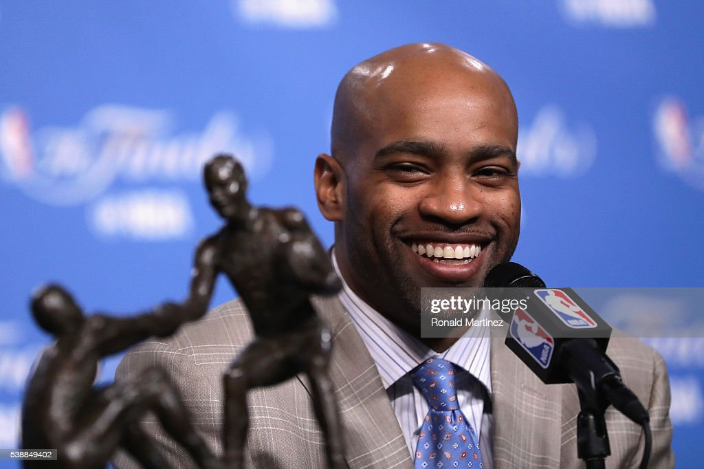 Vince Carter #15 of the Memphis Grizzlies speaks with the media during a press conference after being awarded the 2015-16 Twyman-Stokes Teammate of the Year Award prior to Game 3 of the 2016 NBA Finals between the Cleveland Cavaliers and the Golden State Warriors at Quicken Loans Arena on June 8, 2016 in Cleveland, Ohio.