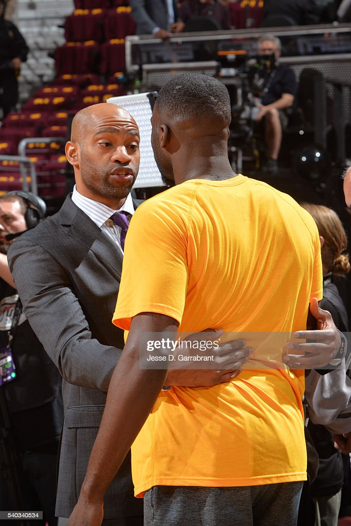 Vince Carter #15 of the Memphis Grizzlies talks to Draymond Green #23 of the Golden State Warriors before Game Four of the 2016 NBA Finals against the Cleveland Cavaliers at The Quicken Loans Arena on June 10, 2016 in Cleveland, Ohio.