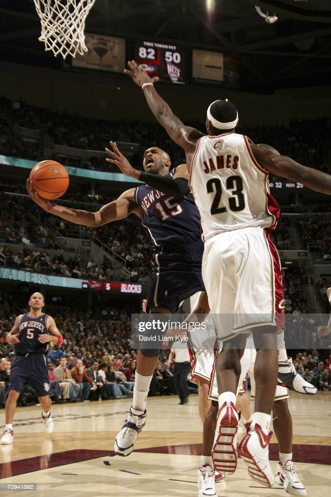 lebron new jersey. vince carter #15 of the new jersey nets drives to basket on lebron james lebron