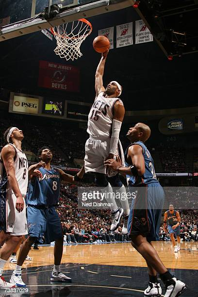 Vince Carter of the New Jersey Nets dunks against Jarvis Hayes of the Washington Wizards on April 7 2007 at the Continental Airlines Arena in East...