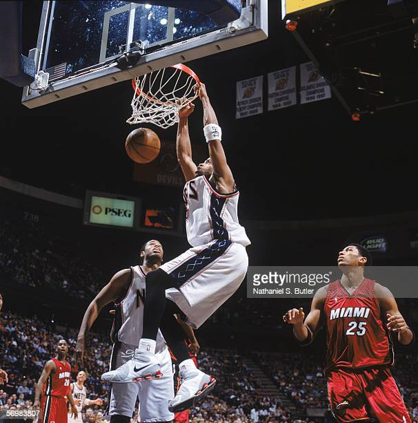 Vince Carter of the New Jersey Nets dunks against the Miami Heat at the Continental Airlines Arena on February 4 2006 in East Rutherford New Jersey...