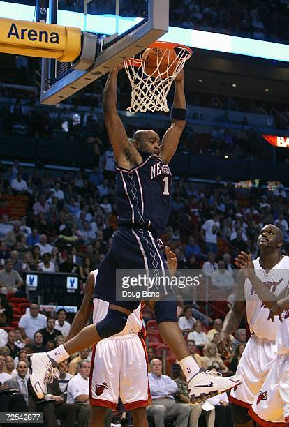 Vince Carter of the New Jersey Nets dunks against the Miami Heat at American Airlines Arena on November 3 2006 in Miami Florida The Heat won 9185...