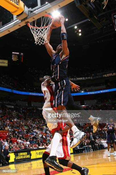 Vince Carter of the New Jersey Nets dunks against the Miami Heat on December 23 2005 at American Airlines Arena in Miami Florida NOTE TO USER User...