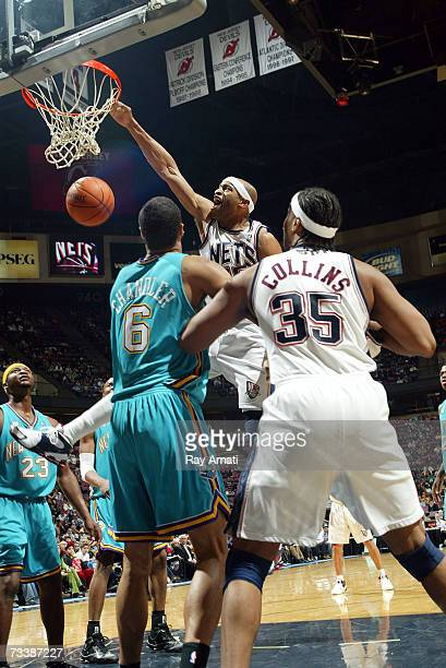 Vince Carter of the New Jersey Nets dunks against the New Orleans/Oklahoma City Hornets on February 21 2007 at the Continental Airlines Arena in East...