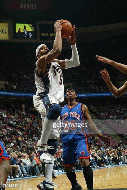 Vince Carter of the New Jersey Nets dunks against the New York Knicks on February 25 2007 at the Continental Airlines Arena in East Rutherford New...