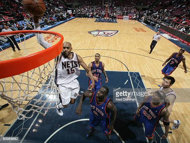 Vince Carter of the New Jersey Nets dunks against the New York Knicks on December 10 2008 at the IZOD Center in East Rutherford New Jersey NOTE TO...