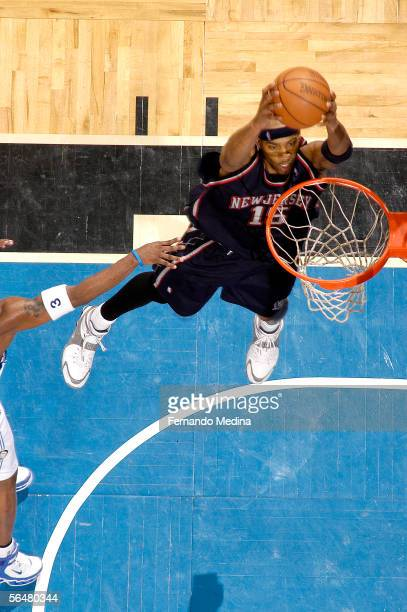 Vince Carter of the New Jersey Nets dunks against the Orlando Magic December 21 2005 at TD Waterhouse Centre in Orlando Florida NOTE TO USER User...