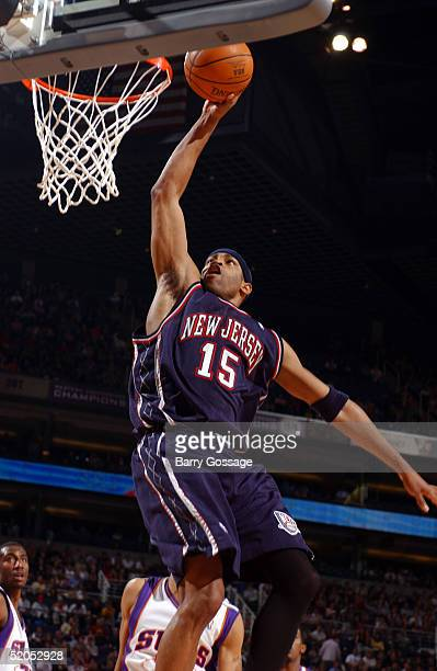 Vince Carter of the New Jersey Nets dunks against the Phoenix Suns on January 23 2005 at America West Arena in Phoenix Arizona NOTE TO USER User...
