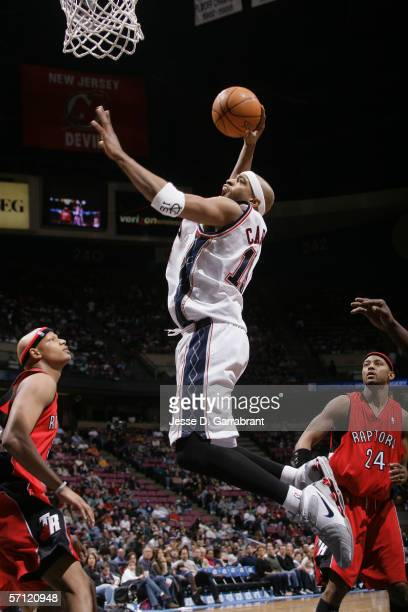 Vince Carter of the New Jersey Nets dunks against the Toronto Raptors at the Continental Airlines Arena on March 4 2006 in East Rutherford New Jersey...