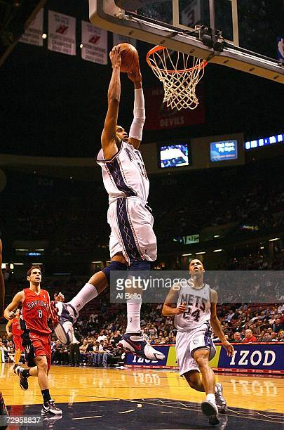 Vince Carter of the New Jersey Nets dunks against the Toronto Raptors on January 9 2007 at Continental Airlines Arena in East Rutherford New Jersey...