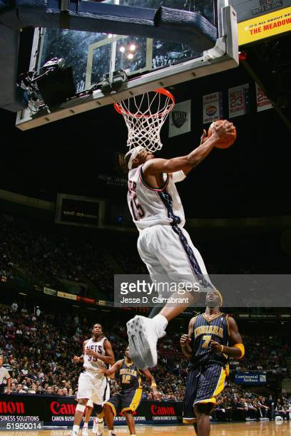 Vince Carter of the New Jersey Nets dunks during the game against the Indiana Pacers on December 30 2004 at the Continental Airlines Arena in East...