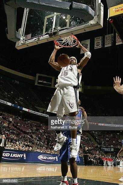 Vince Carter of the New Jersey Nets dunks during the game against the Los Angeles Clippers on December 20 2005 at the Continental Airlines Arena in...