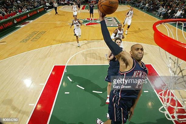 Vince Carter of the New Jersey Nets dunks during the game against the Milwaukee Bucks on April 12 2008 at the Bradley Center in Milwaukee Wisconsin...
