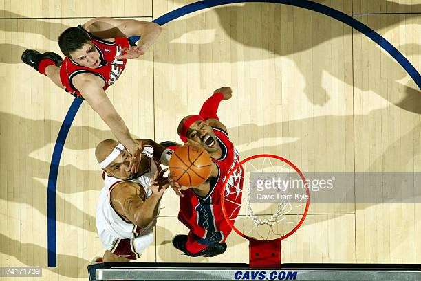 Vince Carter of the New Jersey Nets dunks over Drew Gooden of the Cleveland Cavaliers in Game Five of the Eastern Conference Semifinals during the...