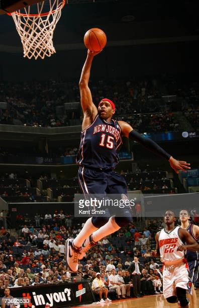 Vince Carter of the New Jersey Nets dunks over the Charlotte Bobcats on March 24 2007 at the Charlotte Bobcats Arena in Charlotte North Carolina NOTE...