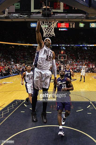 Vince Carter of the New Jersey Nets dunks the ball against LeBron James of the Cleveland Cavaliers during Game Three of the Eastern Conference...
