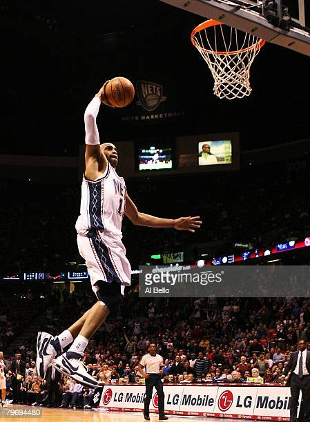 Vince Carter of the New Jersey Nets dunks the ball against the Dallas Mavericks during their game at the Izod Center February 10 2008 in East...