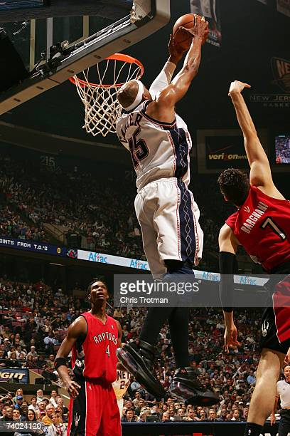 Vince Carter of the New Jersey Nets dunks the ball against the Toronto Raptors in Game Four of the Eastern Conference Quarterfinals during the 2007...