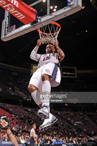Vince Carter of the New Jersey Nets dunks the ball against the Washington Wizards during the game at the Izod Center December 2 2008 in East...