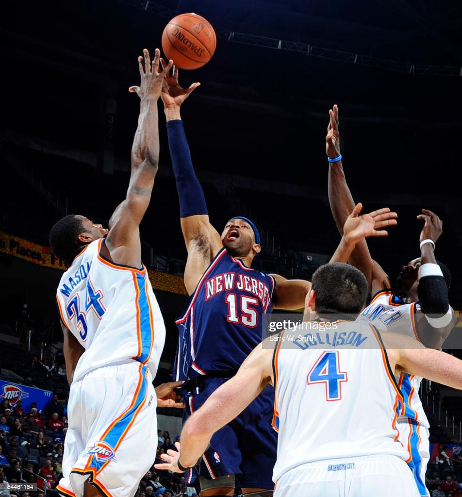 Vince Carter of the New Jersey Nets goes to the basket against Desmond Mason of the Oklahoma City Thunder at the Ford Center on January 26 2009 in...
