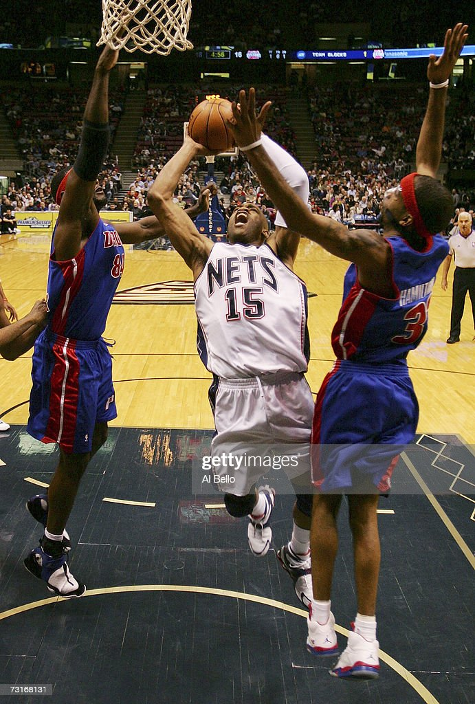Vince Carter #15 of the New Jersey Nets goes to the basket as Richard Hamilton #32 of the Detroit Pistons defends at Continental Airlines Arena January 31, 2007 in East Rutherford, New Jersey.