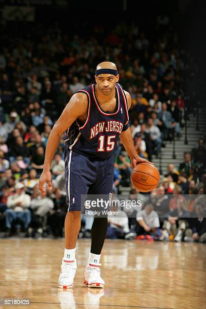 Vince Carter of the New Jersey Nets moves the ball during the game with the Golden State Warriors at the Arena in Oakland on January 26 2005 in...