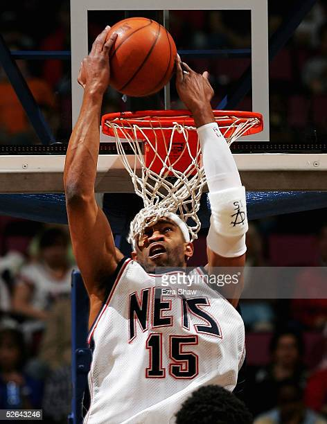 Vince Carter of the New Jersey Nets slams dunks a pass during the first quarter of their game against Philadelphia 76ers on April 17 2005 at...