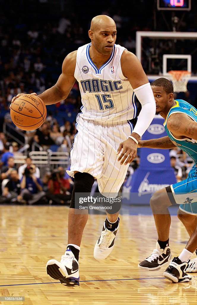 <a gi-track='captionPersonalityLinkClicked' href=/galleries/search?phrase=Vince+Carter&family=editorial&specificpeople=201488 ng-click='$event.stopPropagation()'>Vince Carter</a> #15 of the Orlando Magic drives toward the basket during the game against the New Orleans Hornets at Amway Arena on October 10, 2010 in Orlando, Florida.