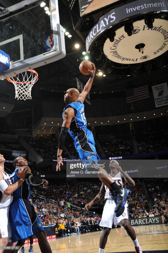 <a gi-track='captionPersonalityLinkClicked' href=/galleries/search?phrase=Vince+Carter&family=editorial&specificpeople=201488 ng-click='$event.stopPropagation()'>Vince Carter</a> #15 of the Orlando Magic dunks against <a gi-track='captionPersonalityLinkClicked' href=/galleries/search?phrase=Anthony+Morrow&family=editorial&specificpeople=814354 ng-click='$event.stopPropagation()'>Anthony Morrow</a> #22 of the New Jersey Nets during the game on November 13, 2010 at the Prudential Center in Newark, New Jersey.