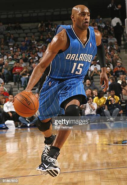 Vince Carter of the Orlando Magic moves the ball against the Dallas Mavericks during the preseason game at the American Airlines Center on October 5...