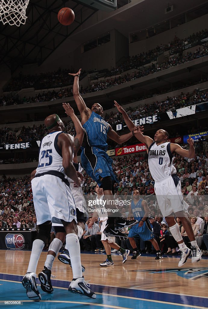 Vince Carter #15 of the Orlando Magic puts up the floater against Erick Dampier #25 of the Dallas Mavericks during a game at the American Airlines Center on April 1, 2010 in Dallas, Texas.