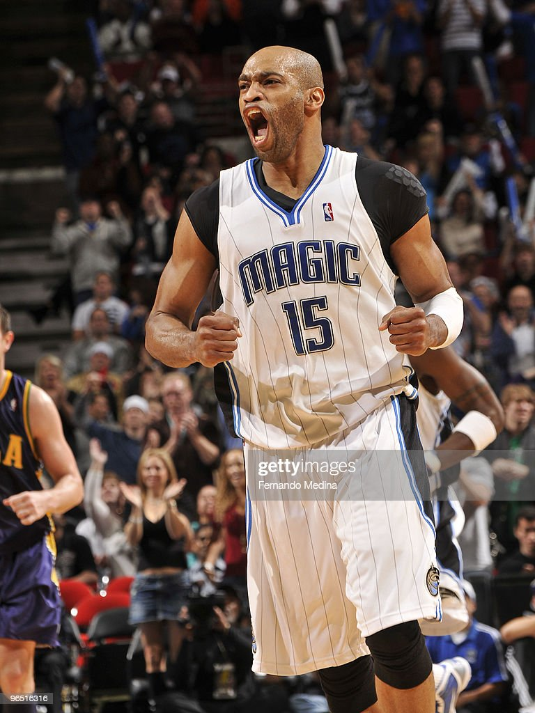 <a gi-track='captionPersonalityLinkClicked' href=/galleries/search?phrase=Vince+Carter&family=editorial&specificpeople=201488 ng-click='$event.stopPropagation()'>Vince Carter</a> #15 of the Orlando Magic reacts after making a three point shot against the New Orleans Hornets during the game on February 8, 2010 at Amway Arena in Orlando, Florida.