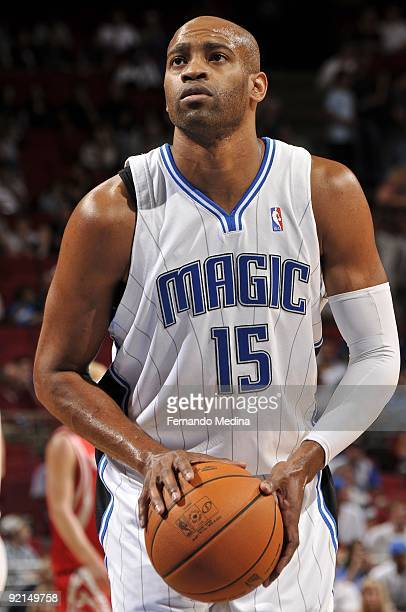 Vince Carter of the Orlando Magic shoots a free throw during the preseason game against the Houston Rockets on October 9 2009 at Amway Arena in...